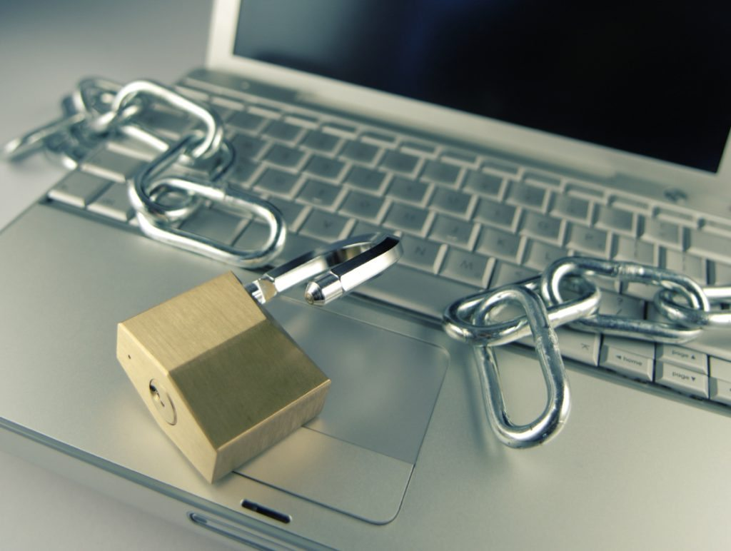 Image of a padlock and chains on a laptop